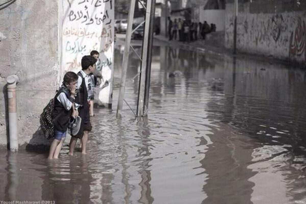 Palestinian school children can be seen in sewage water [Undated file photo / Twitter]