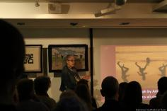 Jan Chalmers (co-founder of Palestinian History Tapestry project) stands up and speaks on the tapestries in London on 11 December 2018 [Abdelrahman Said/Middle East Monitor]