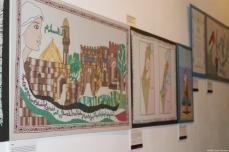 Three pieces of tapestry are displayed at the Palestine History Tapestry event at the P21 Gallery in London on 11 December 2018 [Middle East Monitor]