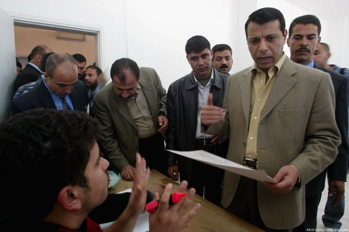 Former Palestinian Cabinet Minister, Mohammed Dahlan (R), votes for the Fatah primaries at a polling station in Khan Younis, southern Gaza Strip, 28 November, 2005. [Abid Katib/Getty Images]