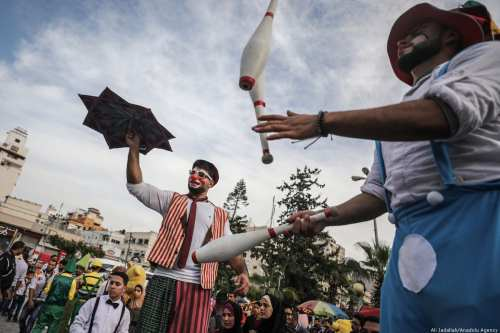 "Jugglers perform during ""Street Carnival"" in Gaza City, Gaza on the 29 November 2018 [Ali Jadallah/Anadolu Agency]"