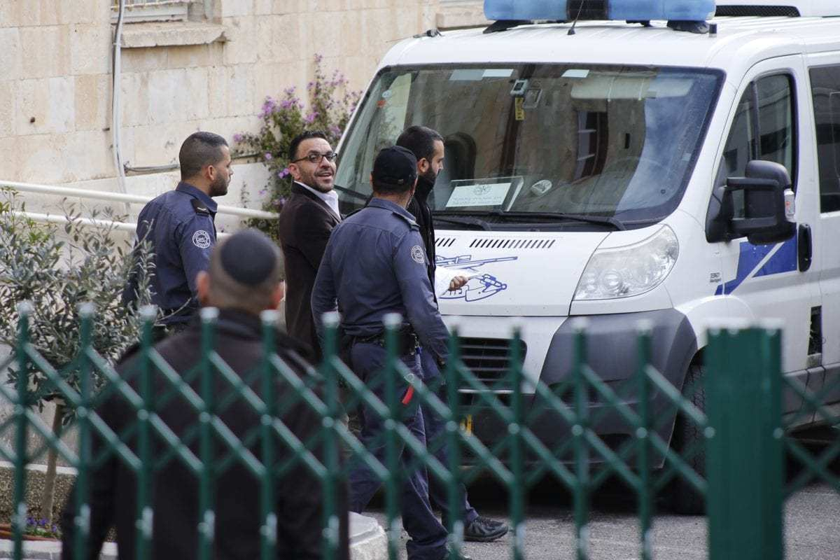 Jerusalem governor Adnan Ghaith (3rd R) is seen after Israeli court on Sunday ordered the release of him in Jerusalem on December 2, 2018 [Mostafa Alkharouf / Anadolu Agency]