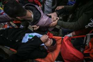 "A Palestinian is being carried away after being injured by Israeli forces during a protest within the ""Great March of Return"" demonstrations in Shuja'iyya neighborhood of Gaza City, Gaza on December 07, 2018. ( Ali Jadallah - Anadolu Agency )"