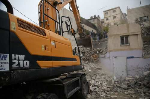 A Palestinian family demolish a large part of their house to avoid paying the Jerusalem Municipality any demolishing costs due to the financial impossibilities in Jerusalem on 8 December, 2018. [Mostafa Alkharouf/Anadolu Agency]