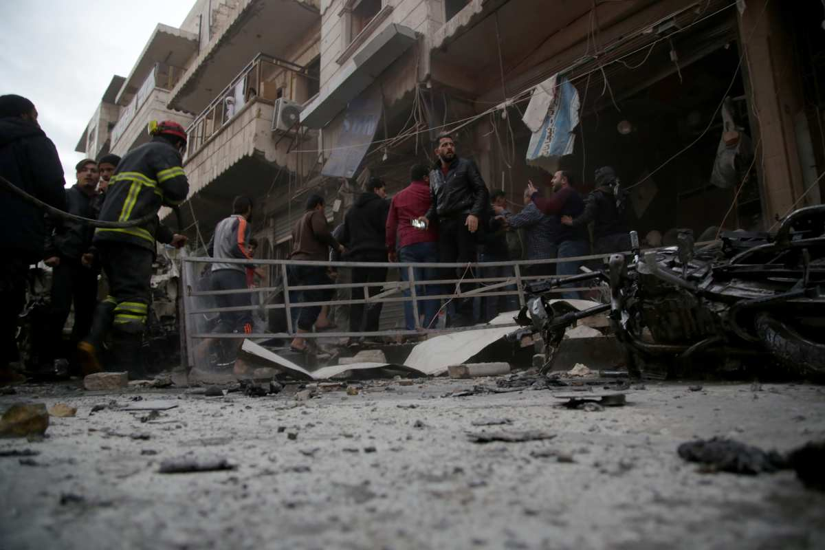 Members of White Helmets conduct a search and rescue operation after a bomb-laden vehicle exploded in Al-Bab district of Aleppo, Syria on 12 December, 2018 [Bekir Kasım/Anadolu Agency]