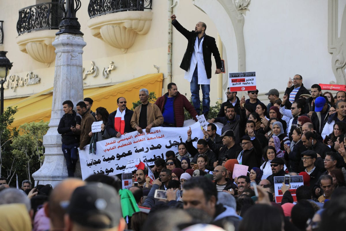 High school and secondary school teachers stage a demonstration demanding wage increase, early retirement and education reform in front of the Tunisian General Labour Union building as they march to the Habib Burgiba Avenue in Tunis, Tunisia on December 12, 2018. ( Nacer Talel - Anadolu Agency )