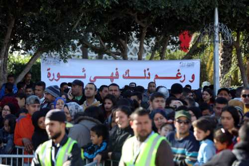 People attend the unemployment protests as they gather to mark the celebration for 8th anniversary of revolution at Bouazizi Square in Sidi Bou Said, Tunisia on December 17, 2018. ( Yassine Gaidi - Anadolu Agency )