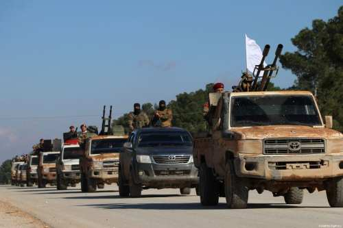 Hamza Division, a member of the Turkey-backed Free Syria Army (FSA), dispatch fighters and armored vehicles to the Manbij border line in Syria's Al-Bab town on December 28, 2018 [Hişam el Homsi / Anadolu Agency]