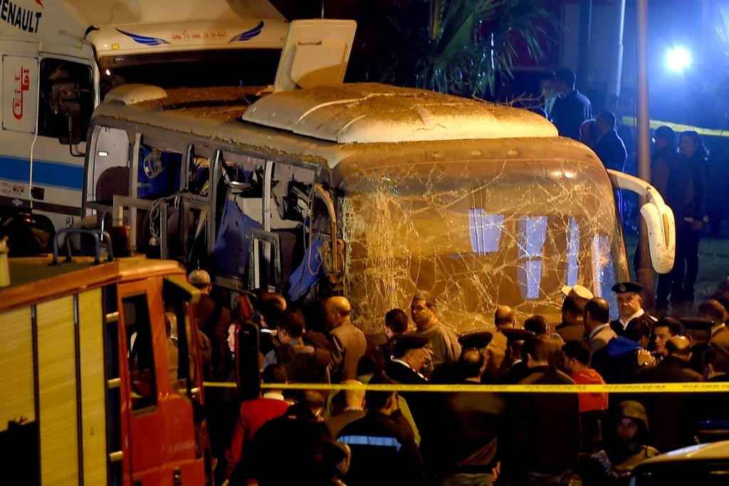 Egyptian officials visit the scene of an attack on a tourist bus in Giza province south of the Egyptian capital Cairo on 28 December, 2018