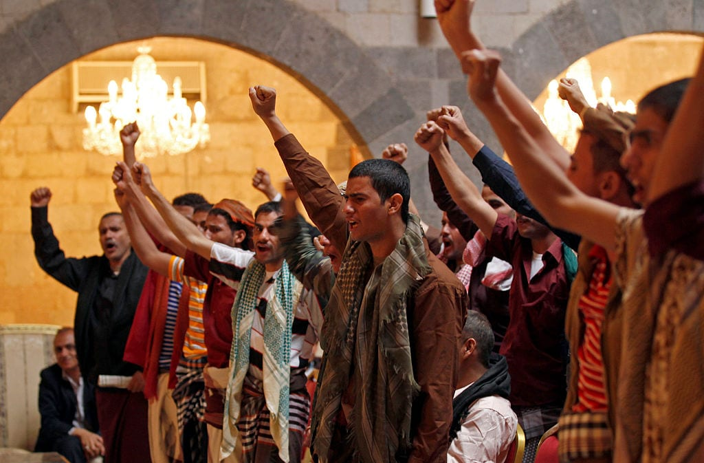 Just freed Yemeni prisoners attend a meeting with the leader of the Huthi Shiite rebels' Supreme Political Council on January 31, 2017 (Photo by MOHAMMED HUWAIS/AFP/Getty Images)