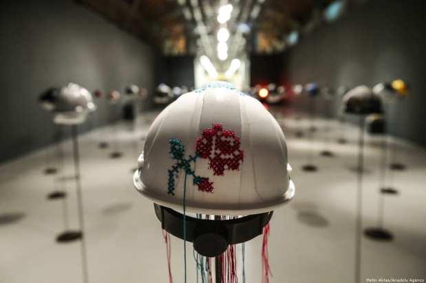 "An artwork helmet is being displayed during ""Deus Ex Machina"" exhibition, owned by Mehmet Ali Ak and Sezer Ak, at CerModern in Ankara, Turkey on 20 December 2018 [Metin Aktas/Anadolu Agency]"