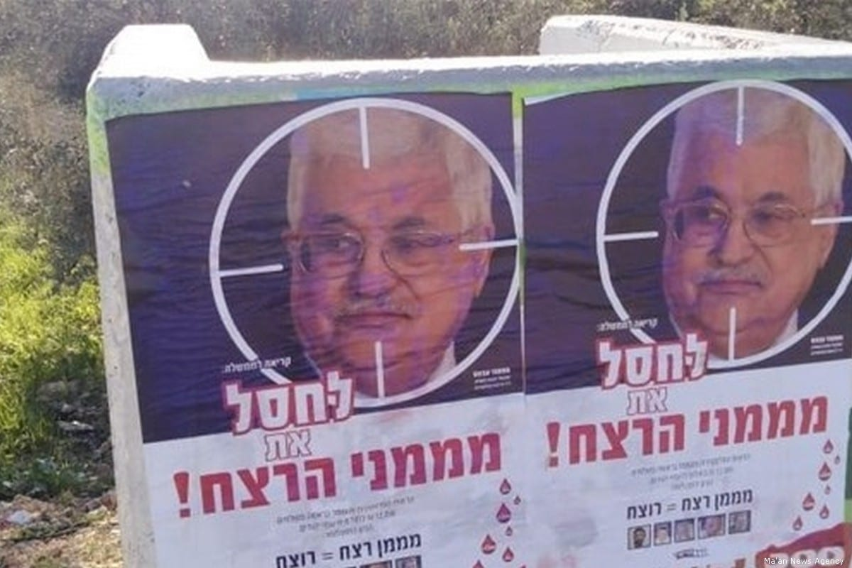 Settlers put up posters calling for the assassination of President Abbas on 11 December 2018 [Ma'an News Agency]