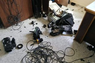 """Anonymous masked assailants broke into the headquarters of Palestine tv in #Gaza assaulting the workers and destroying the surveillance cameras and devices and equipment and the studios of """"Voice of Palestine"""" Radio station. [JS Committee/Twitter]"""
