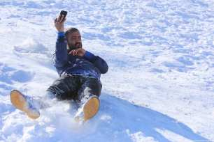 People ski during a Snow Festival in Sulaymaniyah, Iraq on 22 January 2019 [Feriq Fereç/Anadolu Agency]