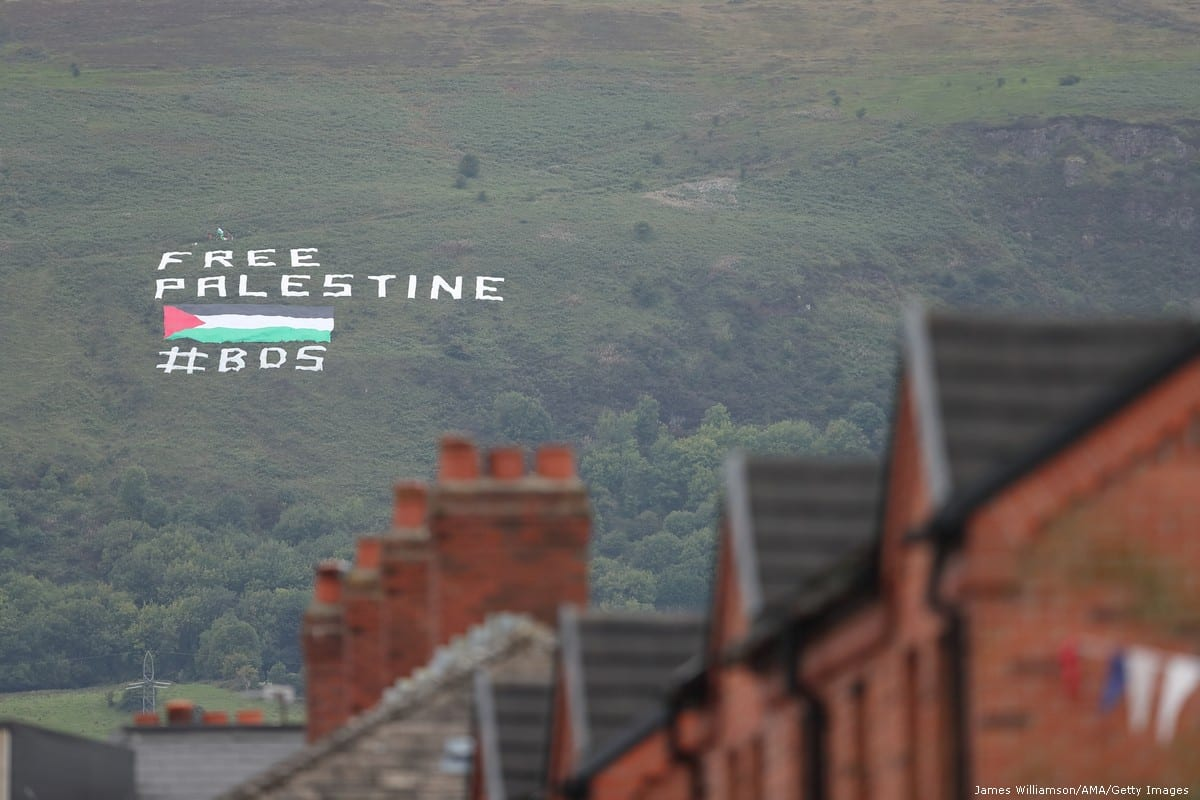 A protest banner against Israel saying 'Free Palestine' and calling for the support of BDS is seen in Belfast, Northern Ireland [James Williamson/AMA/Getty Images]