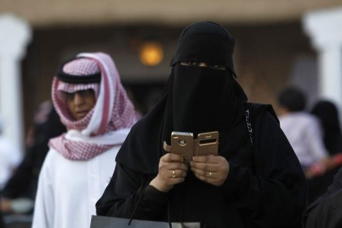 A woman using an her phone Riyadh, Saudi Arabia on 13 February 2012 [REUTERS/Fahad Shadeed]