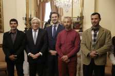 Albanian migrant Jake Gani (2nd R), Egyptian migrants Ibrahim Mahmoud Mousa (R) and Al Haimi Emad (L) are honoured with Greek citizenship for saving the lives of tens of people in July's fire disaster near the capital Athens, by Greek President Prokopis Pavlopoulos (2nd L) with an official ceremony at the Greek Presidency Building in Athens, Greece on 2 January, 2019 [Ayhan Mehmet/Anadolu Agency]
