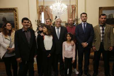 Albanian migrant Jake Gani (3rd R), Egyptian migrants Ibrahim Mahmoud Mousa (2nd L) and Al Haimi Emad (R) are honoured with Greek citizenship for saving the lives of tens of people in July's fire disaster near the capital Athens, by Greek President Prokopis Pavlopoulos (C) with an official ceremony at the Greek Presidency Building in Athens, Greece on 2 January, 2019 [Ayhan Mehmet/Anadolu Agency]