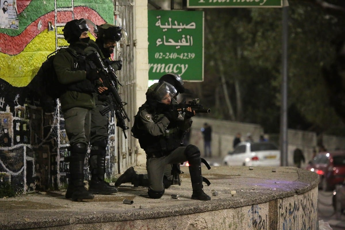 Israeli forces intervene in Palestinians with plastic bullets during a protest after Israeli forces made raid on houses and shops in Ramallah, West Bank on January 7, 2019. ( Issam Rimawi - Anadolu Agency )