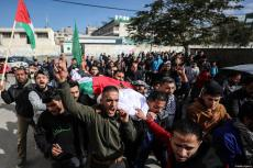 Dead body of Palestinian woman, Amal Mustafa Abu Sultan, 44, who was killed by Israeli army gunfire while taking part in ongoing demonstrations near the Gaza-Israel buffer zone, is being carried during her funeral ceremony in Gaza on 12 January 2019 [Mustafa Hassona / Anadolu Agency]