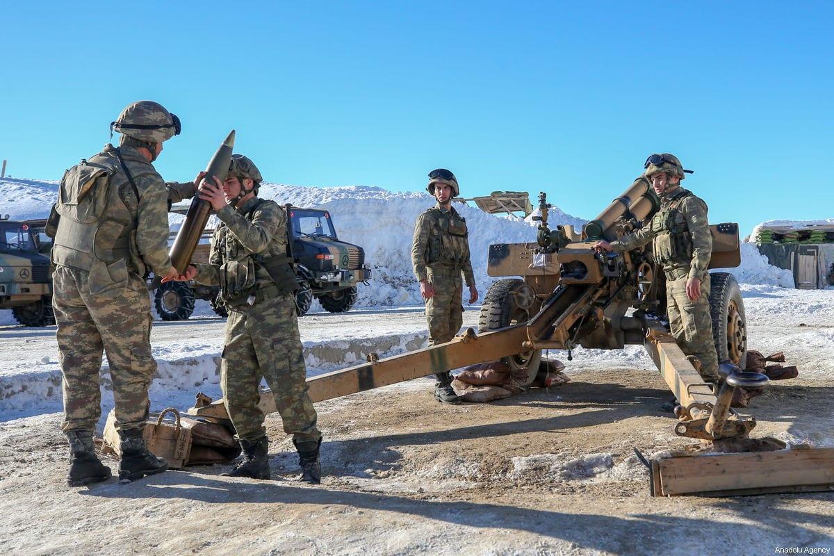 Turkish soldiers prepare to fire a cannon at a military base during winter near Turkey-Iraq border in Daglica village of Yuksekova district of Hakkari, Turkey on January 20, 2019 [Özkan Bilgin / Anadolu Agency]
