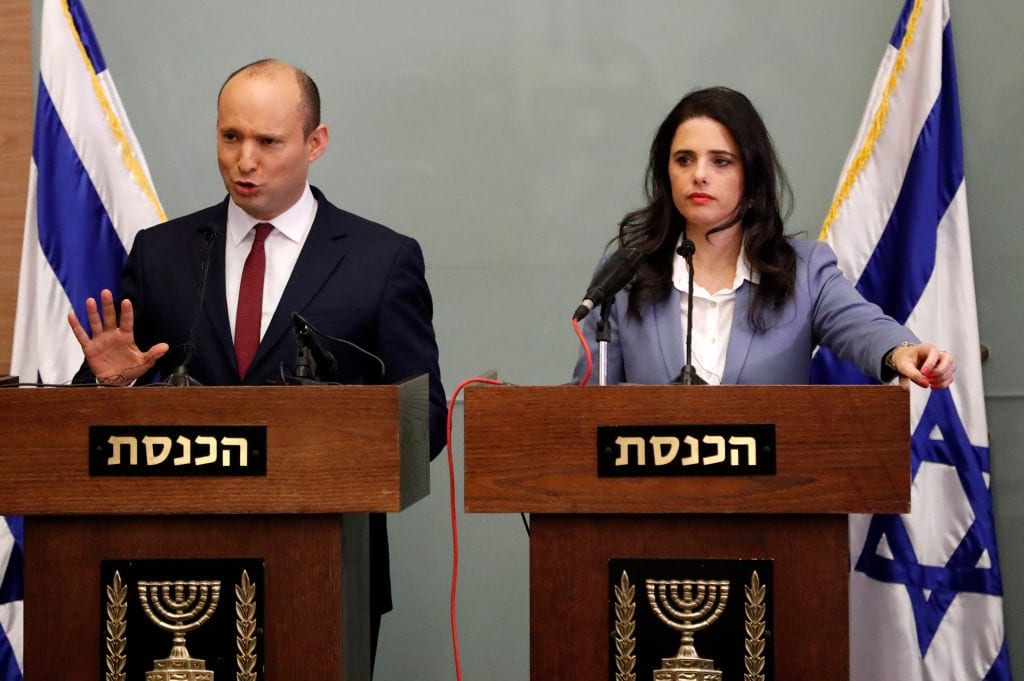 Israeli Education Minister Naftali Bennett (L) speaks as he and Justice Minister Ayelet Shaked (R) give a statement at the Knesset in Jerusalem on 19 November, 2018 [THOMAS COEX/AFP/Getty Images]