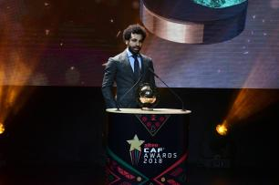 Liverpool's Egyptian forward Mohamed Salah speaks on stage after winning the 2018 African Footballer of the Year Award also called Ballon d'Or during the CAF award ceremony in Dakar, Senegal 8 January 2019 [SEYLLOU/AFP/Getty Images]