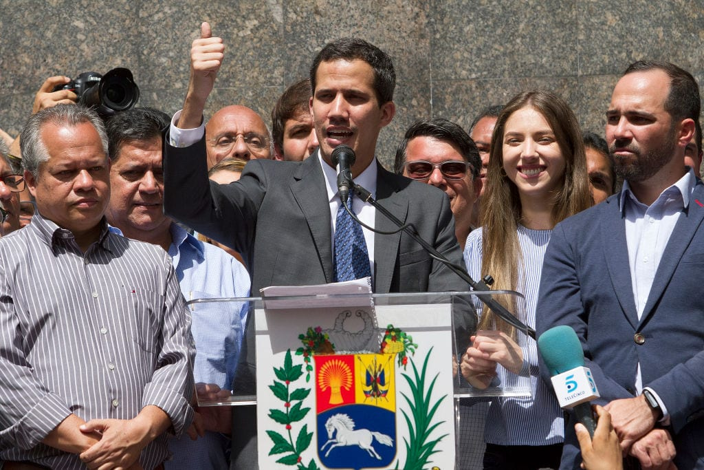 Juan Guaidó, who has appointed himself interim president speaks during a meeting with deputies, media and supporters organized by the National Assembly at Plaza Bolivar of Chacao on 25 January 2019 in Caracas, Venezuela. [Leo Alvarez/Getty Images]