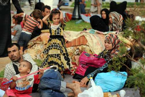 Syrian nationals fleeing the conflict in their home country gather in a garden in Port Said Square in Algiers on 28 July, 2012 [FAROUK BATICHE/AFP/Getty Images]