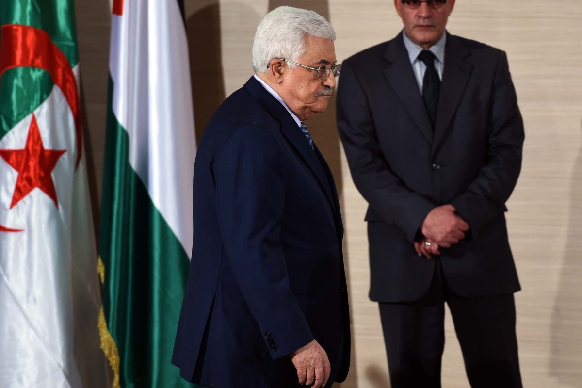 Palestinian President Mahmud Abbas leaves after a press conference at the Ministry of Foreign Affairs on 23 December 2014, in Algiers [FAROUK BATICHE/AFP/Getty Images]