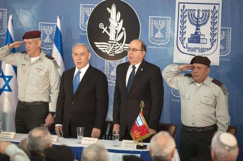 Israel's new Chief of Staff Gadi Eisenkot (R), outgoing chief of staff Benny Gantz (L), Israeli Prime Minister Benjamin Netanyahu (C-L) and Defense Minister Moshe Yaalon attend a swearing-in ceremony at the Prime Minister's Jerusalem offices on 16 February 2015. [MENAHEM KAHANA/AFP/Getty Images]