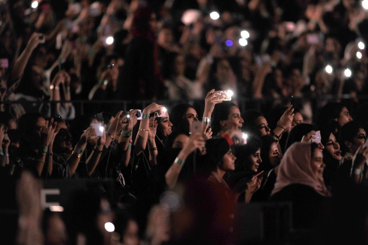 Saudi women attend a concert by Egyptian pop sensation Tamer Hosny in Jeddah on 30 March 2018 [AMER HILABI/AFP/Getty Images]