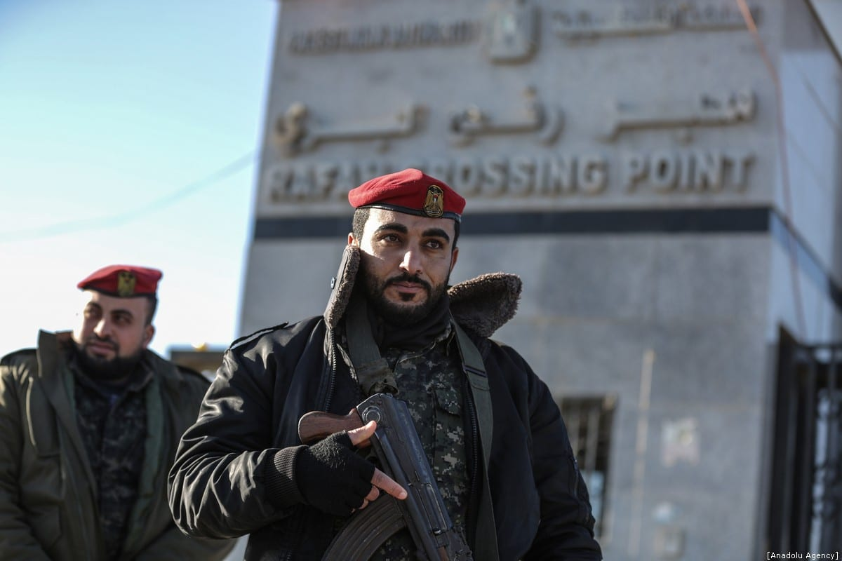 A view of Rafah Crossing Point is seen as Interior Ministry members standing in front of the entrance, on January 07, 2019 in Gaza City, Gaza. The Hamas-run Interior Ministry on Monday assumed responsibility of managing the Rafah border crossing between the Gaza Strip and Egypt. The move came one day after the Ramallah-based Palestinian Authority (PA) suddenly withdrew its personnel from the terminal. ( Ali Jadallah - Anadolu Agency )