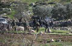 Israeli forces intervene in Palestinians during a protest against discrimination wall and Jewish settlements in Ramallah, West Bank on January 04, 2019. ( Issam Rimawi - Anadolu Agency )
