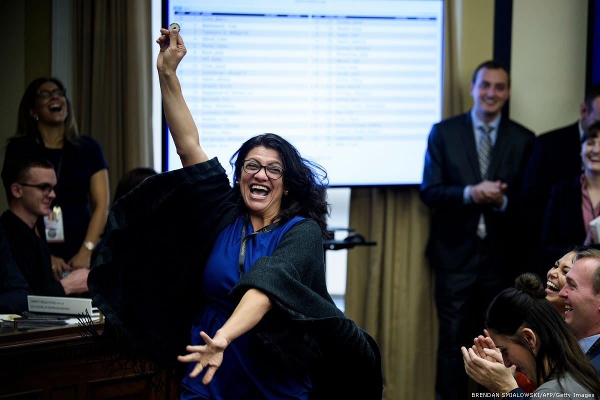 Rashida Tlaib, the first Palestinian congresswoman celebrates after drawing the number 8 in the lottery draw for congressional offices 30 November 2018 in Washington, US [Win McNamee/Getty Images]