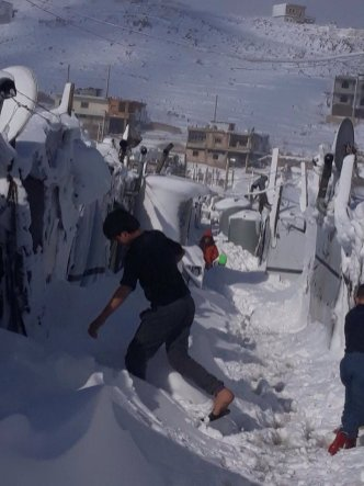 Syrian refugees have been left in the freezing cold after snow storms hit [Twitter]