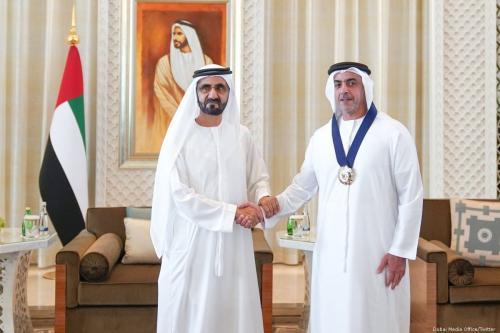 UAE Prime Minister and Emir of Dubai Sheikh Mohammed bin Rashid Al Maktoum (L) with one of the winners of the Gender Balance Index 2018 [Dubai Media Office/Twitter]