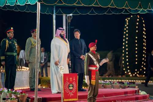 Crown Prince of Saudi Arabia Mohammad bin Salman is welcomed by Prime Minister of Pakistan Imran Khan ahead of their meeting in Islamabad, Pakistan on 17 February 2019 [Bandar Algaloud/Saudi Kingdom Council/Handout/Anadolu Agency]