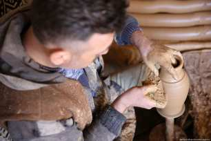 Turkish craftsmen Yenal Yorgun (R) and Mustafa Alkan (L) make clay pots in Cappadocia's Avanos district, Nevsehir, Turkey on 5 February 2019 [Behçet Alkan/Anadolu Agency]