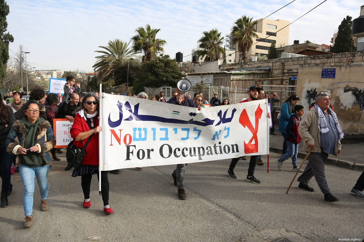 Israeli and foreigner peace activists stage a protest against Israeli authorities' decision on evacuating Palestinian families who live in Sheikh Jarrah neighborhood of Eastern Jerusalem on 01 February 2019. [Faiz Abu Rmeleh - Anadolu Agency]