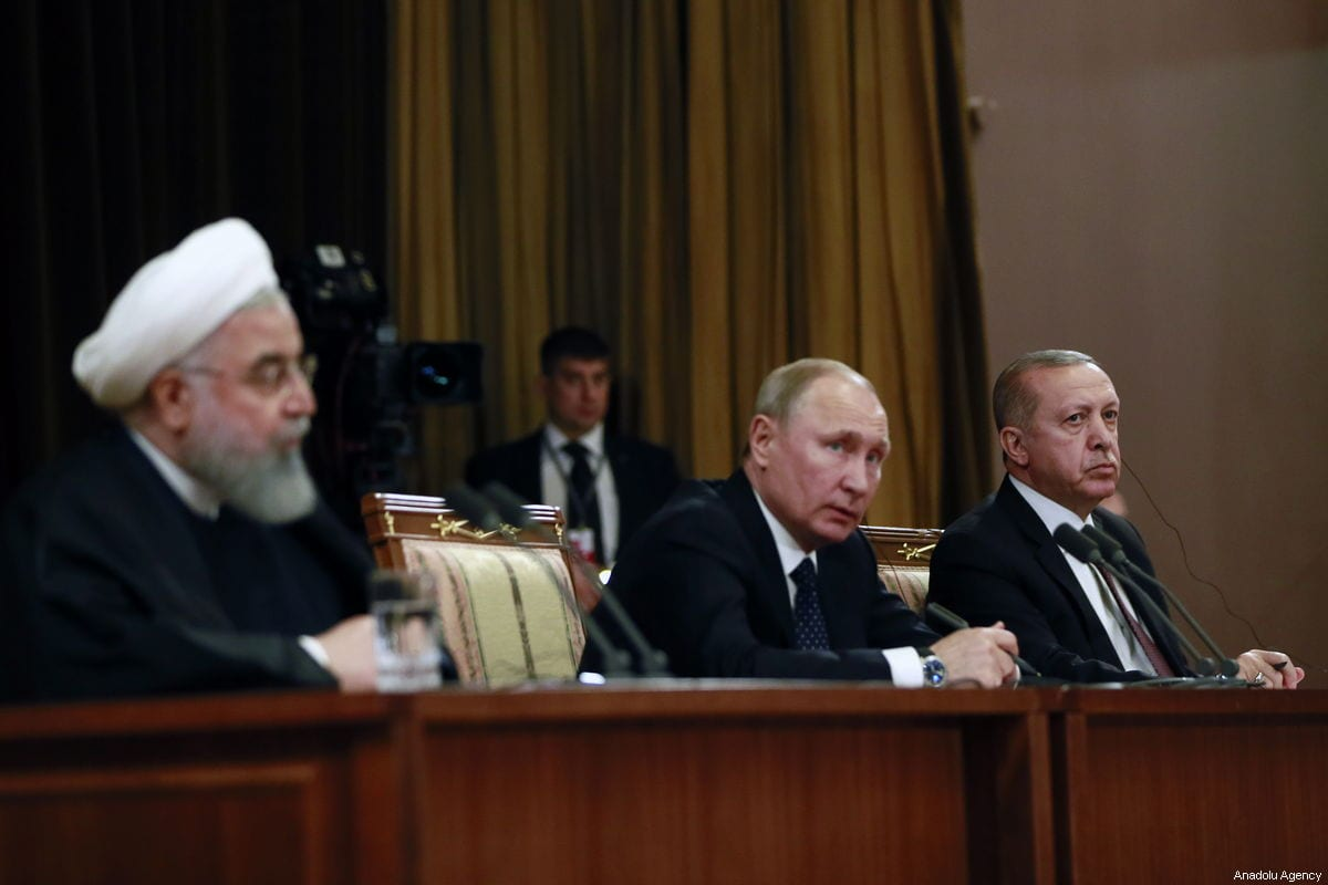 Turkish President Recep Tayyip Erdogan (R), Iranian President Hassan Rouhani (L) and Russian President Vladimir Putin (C) in Sochi, Russia on 14 February 2019 [Turkish Presidency/Anadolu Agency]