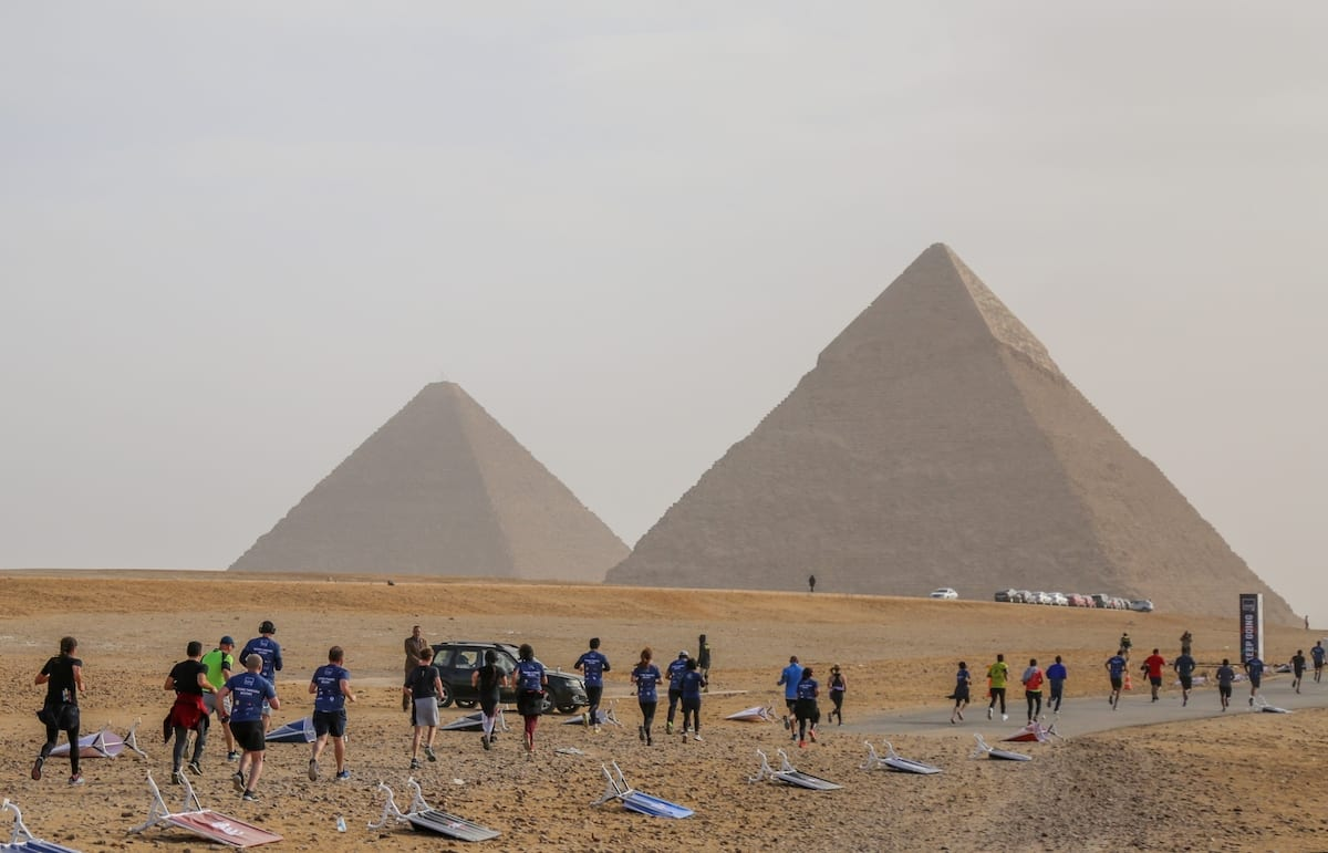People gathered around the Great Pyramid of Giza, which is located in the western part of capital city Cairo, in Egypt on 15 February 2019 [Ahmed Al Sayed/Anadolu Agency]