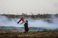 """Palestinians are seen as Israeli forces intervene them with tear gas during a """"Great March of Return"""" demonstration at Huzaa district of Khan Yunis, Gaza on February 15, 2019. ( Mustafa Hassona - Anadolu Agency )"""