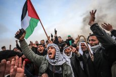 """Palestinians shout slogans as Israeli forces intervene protestors during a """"Great March of Return"""" demonstration at Huzaa district of Khan Yunis, Gaza on 15 February 2019. [Mustafa Hassona - Anadolu Agency]"""