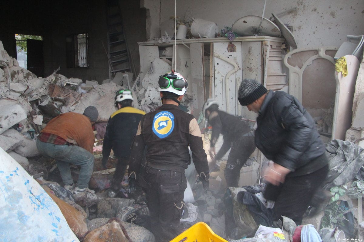 Members of White Helmets conduct a search and rescue operation after Assad Regime forces' artillery units attacked within the borders of the tension reduction zone determined for Idlib in Khan Shaykhun district of Idlib, Syria on 15 February 2019. ( Enes Diyab - Anadolu Agency )