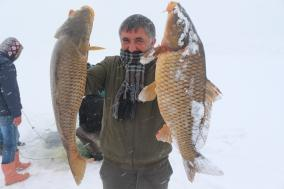 Fishing down frozen water in Turkey is not just a hobby; it is a profession that many fishermen rely on to secure their day's worth. The forms of fishing are varied among amateurs and professionals in the Yazji dam lake in the state of Agri (east), one of the coldest regions of Turkey in winter on 21 February 2019 [Abdullah Söylemez/Anadolu]