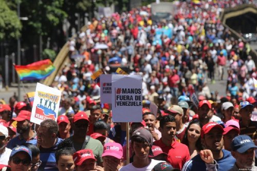 Supporters of Venezuelan President Nicolas Maduro take part in a demonstration in Caracas, Venezuela on February 23, 2019 [Venezuelan Presidency / Handout - Anadolu Agency]