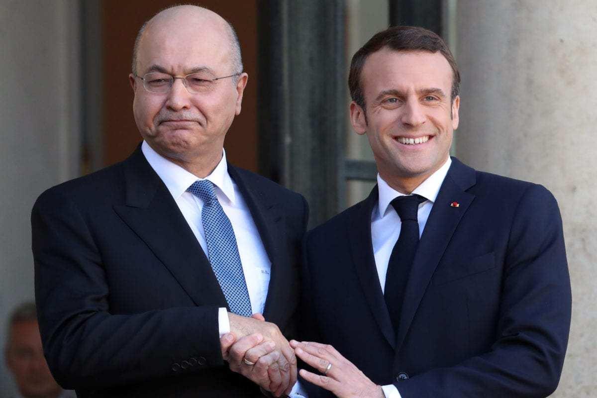 French President Emmanuel Macron (R) welcomes Iraqi President Barham Salih (L) at the Elysee Palace in Paris, France on 25 February 2019. [Mustafa Yalçın - Anadolu Agency]