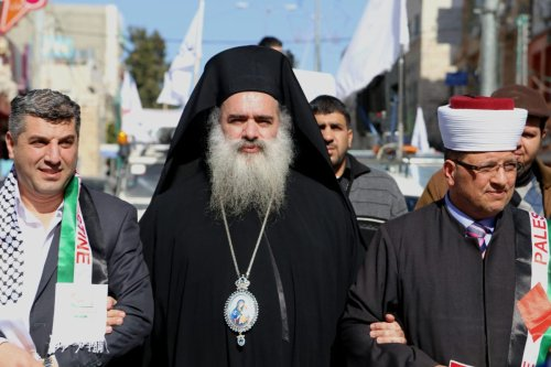 Archbishop of Jerusalem's Greek Orthodox Church, Atallah Hanna [centre], seen during a protest in the West bank city of Hebron on 22 January 2015 [Muhesen Amren / ApaImages]