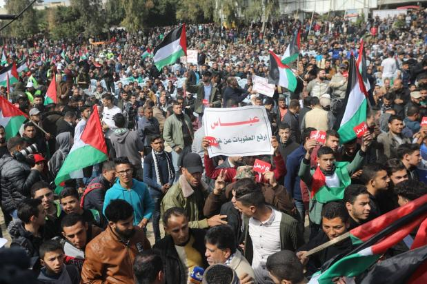 Palestinian protestors seen at a protest in Gaza's Saraya Square, calling for the resignation of Mahmoud Abbas, on 24 February 2019 [Mohammed Asad - Middle East Monitor]